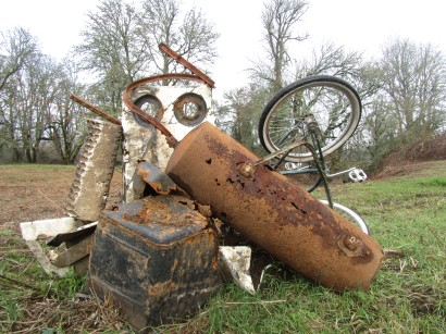 Bike and junk found under weeds